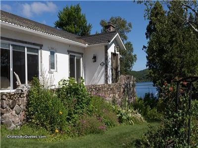 Tremblant Peninsula on the lake  is an exceptional waterfront 2200 SF Home 4 Bedrooms, 4 bathrooms