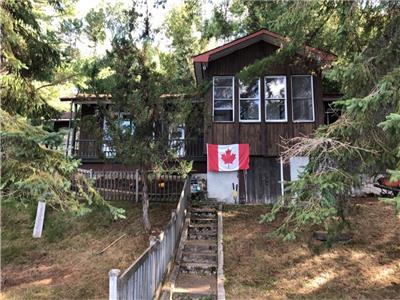 4 season waterfront home with 200 feet of frontage on Johnson's Lake, 1 hour from Ottawa